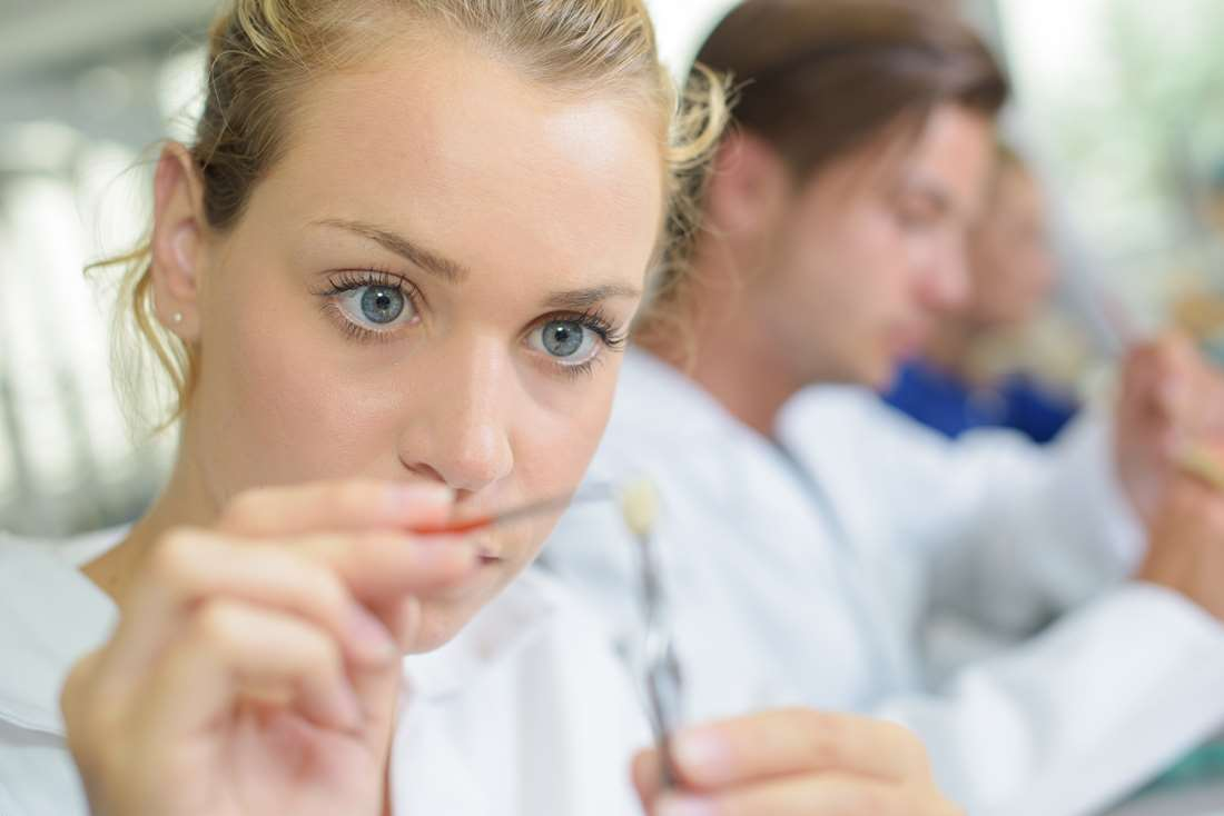 15598361-close-up-of-female-dental-technician-working.jpg